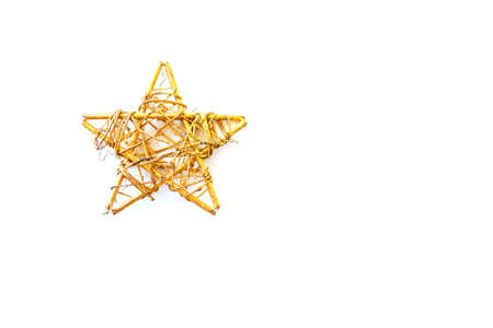 Christmas postcard. Golden decoration vintage star isolated on white background. Top view, copy space. Festive backdrop.