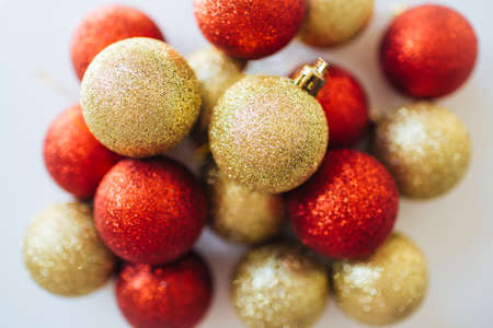 Red and golden Christmas balls decoration overview. New year greeting postcard. Festive backdrop. Фото со стока