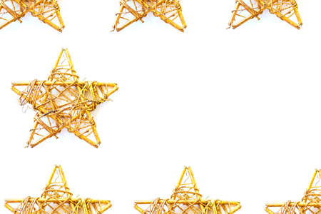 Xmas pattern frame. Decoration with multiple vintage golden stars, isolated on white background. Overview, copy space. Holiday backdrop.