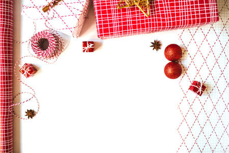 Flat lay with gift boxes, red and white wrapping paper and cute decorations, isolated on white background. Christmas and New Year festive concept.