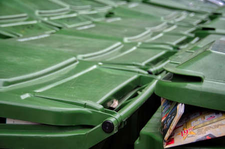 rebate: Lots of green recycle bins with a rebate publicity