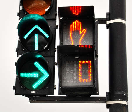 trafic: Circulation lights ; Arrow up to go forward and arrow right to turn right. A stop sign with the red hand and countdown at 0. Stock Photo