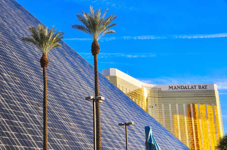 VEGAS, NEVADA, USA - January 11th, 2016: Mandalay bay hotel in background and Luxor hotel in foreground