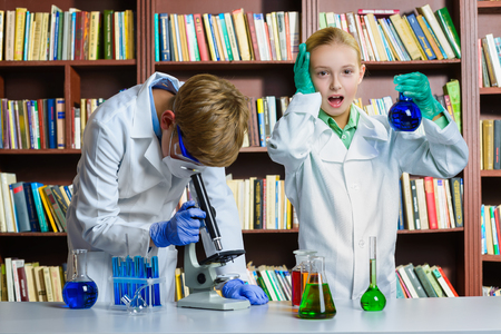 chemistry class: Cute boy and girl doing biochemistry research in chemistry class.