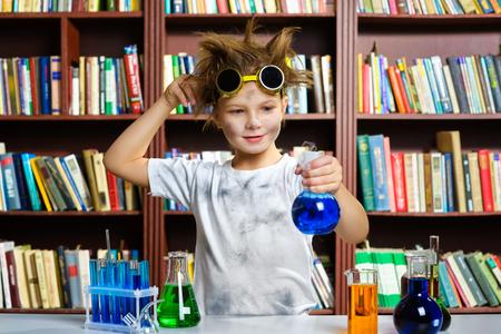 chemistry class: Cute boy doing biochemistry research in chemistry class.