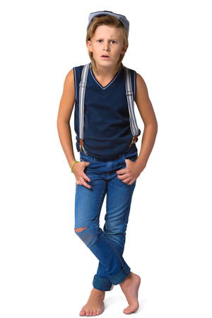 audacious: Cute blonde boy or teenager in full length casual style blue jeans posing isolated on white.