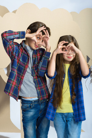 funny boy: boy and girl laid her fingers hearts. Love concept.
