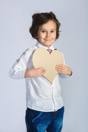 lover boy: Lover Boy holding a cardboard heart. Love concept.