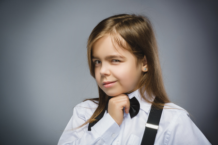 discredit: Closeup Portrait of mistrust girl isolated on gray background.