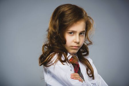 offense: Portrait of offense girl isolated on gray background. Negative human emotion, facial expression. Closeup. Stock Photo