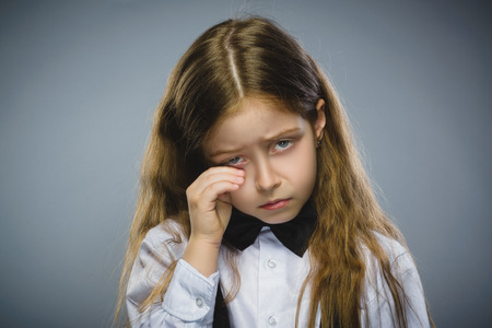 bad behavior: Portrait of offense girl isolated on gray background. Negative human emotion, facial expression. Closeup. Stock Photo