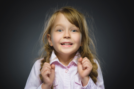 Closeup Portrait of happy girl going surprise isolated on gray background. Stock Photo