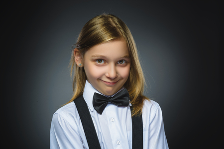 timidity: Closeup portrait shy girl isolated grey background.