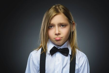 Portrait of offense girl isolated on gray background. Negative human emotion, facial expression. Closeup. Stock Photo