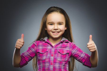 Closeup portrait successful happy girl show thumb up isolated grey background.