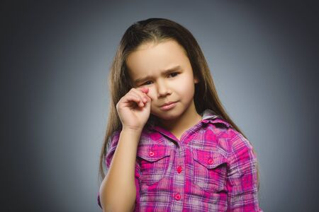 transgression: offense crying girl isolated on gray background Stock Photo