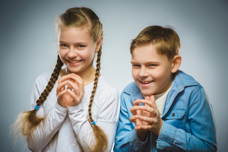 guile: Cunning boy and girl conceived trick. Communication concept.