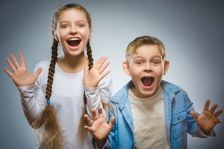 Closeup portrait successful kids. Cheerful boy and girl are happy Stock Photo