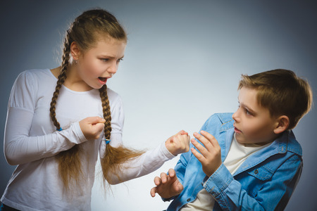 angry girl shouting at frightened dissatisfied boy. Communication concept