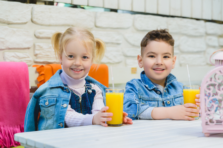 kids having healthy breakfast. children Drinking juices and have fun Zdjęcie Seryjne