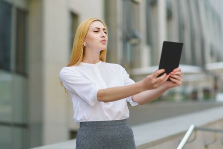 topicality: businesswoman making selfie against the background of office building Stock Photo