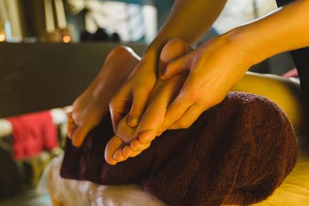 Female massage therapist massaging a beautiful brunette Stock Photo