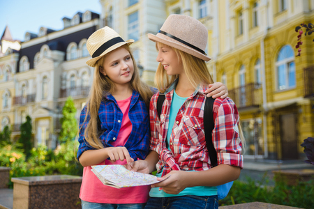 group children looking at map. Travel orTourism and Vacation concept Zdjęcie Seryjne