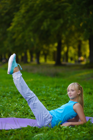 Girl doing gymnastic exercises or exercising outdoor Zdjęcie Seryjne