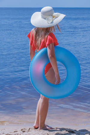 Girl on the beach at sea with a circle