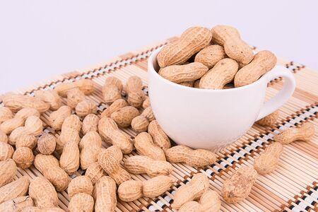 groundnut: Groundnut on white background Stock Photo