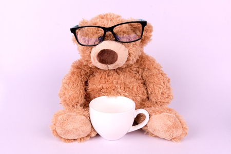 stuff toy: Brown toy bear with cup