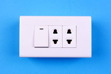 light switch: Electric light switch on blue background Stock Photo