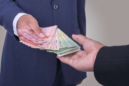gently: Man gently takes a bribe