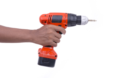 cordless: Hand hold cordless electric screw driver on white background Stock Photo