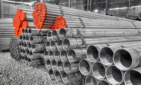 ferrous: Steel Pipes bunch on the rack in warehouse
