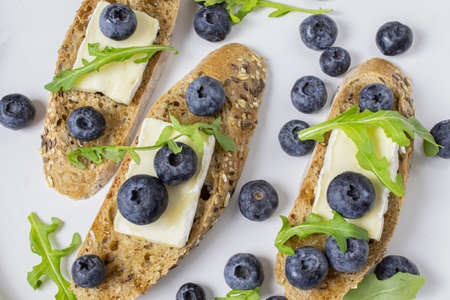 baguette with brie and blueberries Reklamní fotografie