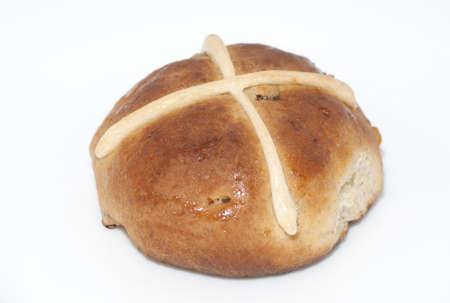 citrus family: Cross bun with raisins and dried apricots