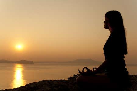 Seaside yoga poses at sunrise photo