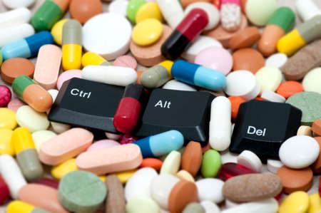 Ctrl, Alt, Del keys among drugs  Enter system, restart system  photo