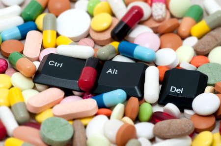 alt: Ctrl, Alt, Del keys among drugs  Enter system, restart system  Stock Photo