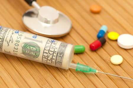 One hundred dollars in syringe among drugs and stethoscope  photo