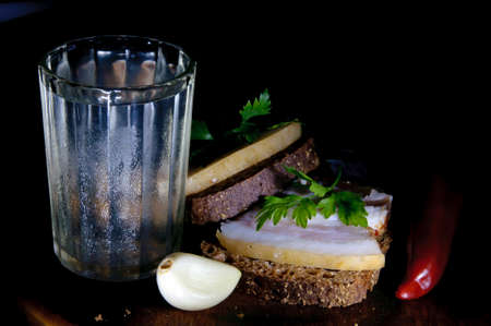 misted: Sandwich with salted lard and misted glass of vodka
