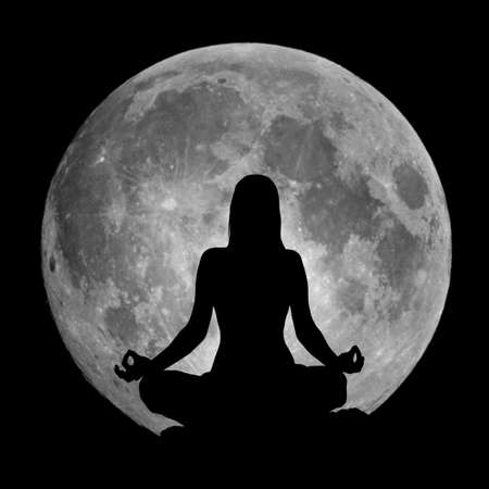 yoga meditation: Yoga lotus position silhouette against the full Moon Stock Photo