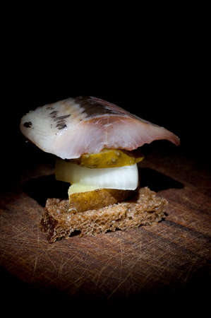 jacket potato: Canape made of herring, pickled cucumber, onion, jacket potato and rye bread