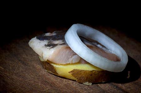 jacket potato: Piece of salted herring on slice of boiled jacket potato