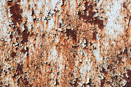 flaky: Rusted metallic surface with flaky paint