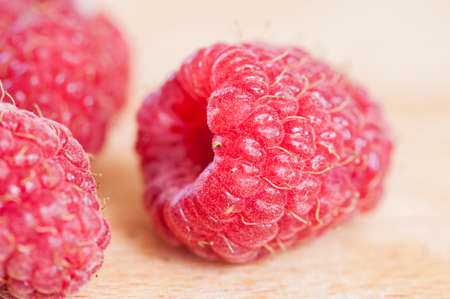 organic raspberry: Ripe organic raspberry close up on log Stock Photo