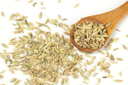 fennel seeds: Fennel seeds close up on white background Stock Photo