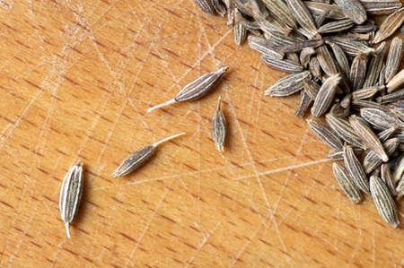cumin: Cumin seeds close up on cutting board Stock Photo