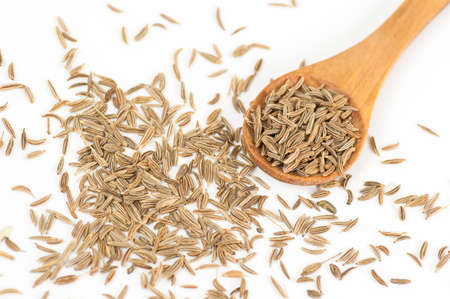 caraway: Caraway (Carum carvi) seeds close up isolated on white Stock Photo